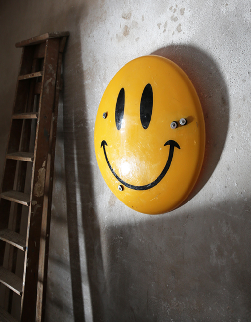 smiley riot shield on wall